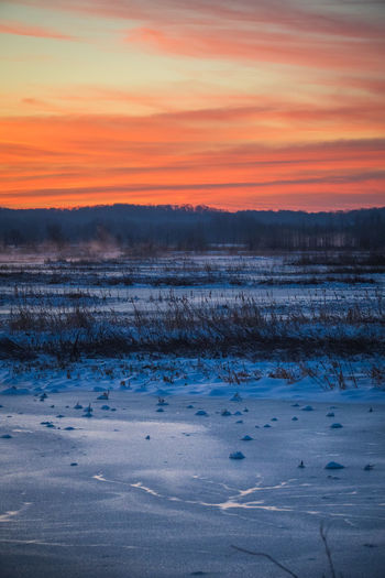 Winter Sunset Cold Temperature Snow Beauty In Nature Tranquility Tranquil Scene Sky Scenics - Nature No People Nature Orange Color Environment Frozen Landscape Non-urban Scene Cloud - Sky Water Idyllic Ice Outdoors Frozen Water