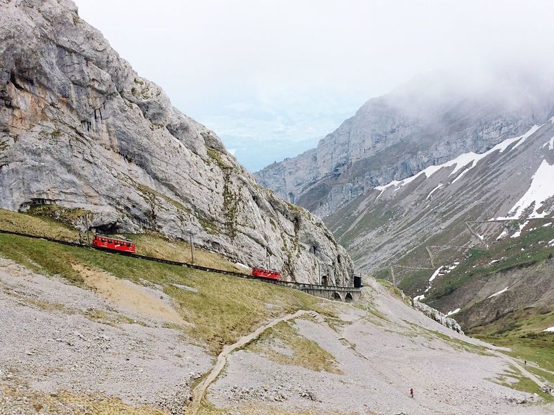 Mountain Mountain Range Beauty In Nature Mode Of Transport Sky Transportation Non-urban Scene Physical Geography Nature Tranquility Outdoors Landscape Scenics Day Mountain Road No People Overhead Cable Car Pilatus Switzerland Miles Away Flying High The Great Outdoors - 2017 EyeEm Awards