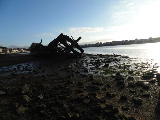 Abandoned Beach Boat Damaged Horizon Over Water Mode Of Transport Moored Nautical Vessel Rippled River Sand Sea Shore Summer Tranquil Scene Water Wood Old Boat Showcase: February By The River Low Tide Nature No Edit No Filter Beauty In Nature Eyeen Gallery