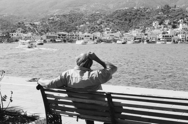 A man sits by the seaside in Istanbul thinking about life passing by. - Photos taken on 35mm film with Canon AE-1 Program analog camera. Streetwise Photography Streetphotography Street Analogue Photography Analog 35mm Film Film Photography Canon AE-1 Canon Canon AE-1 Program  Black And White Blackandwhite Black & White The Week on EyeEm Best Of EyeEm My Best Photo Fomapan Fomapan400 Bench One Person Lifestyles Sea The Art Of Street Photography