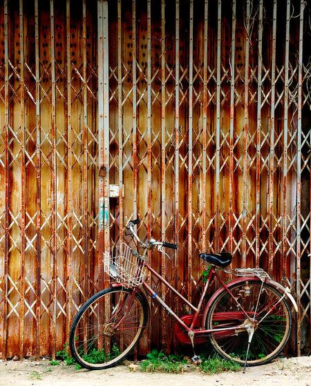 Bicycle Against Metal Grate
