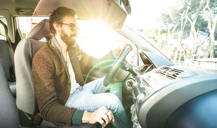 Auto Automobile Beard Car Concept Customer  Dealership Drive Driver Fashion Flare Guy Handsome Happy Hipster Influencer Inside Insurance Lease Life Lifestyle Loan  Male Man Millenial Millennial Mustache Passenger person RENT Rental Road Roadtrip Seat Sitting Style Summer Sun Sunflare Sunglasses Sunshine Test Transport Travel Trendy Vacation Vehicle Vintage Young Youth