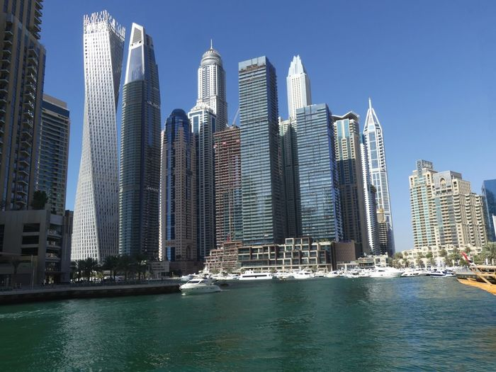 Skyscrapers at the Marina, Dubai, United Arab Emirates 2019 Dubai UAE 2019 Marina Blue Sky Sunlight And Shade Skyscrapers Tower Blocks Towers City Water Waterfront Tall - High No People Low Angle View Glassy Water Urban Skyline Cityscape Modern Architecture Modern Design Glass And Steel Structure Apartments Composition Outdoor Photography Scenics