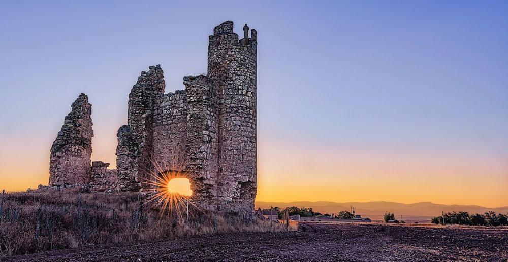 Old Castle Caudilla Toledo SPAIN España Medieval Architecture Ruined Building Ruin Sky Sunset Architecture Nature Built Structure Building Exterior No People Clear Sky Building Outdoors Sunlight Architecture History Travel Destinations Religion The Past Clear Sky Tower Travel Old