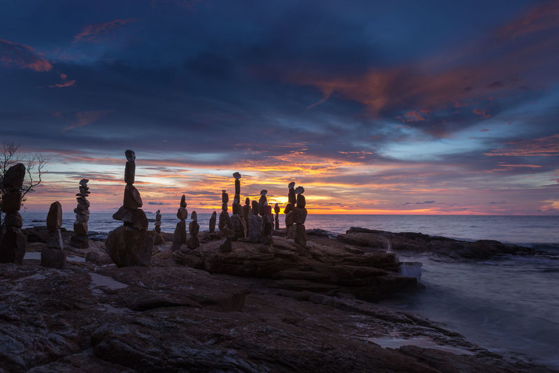 Stones balance on beach at sunset Beach Beauty In Nature Land Nature Orange Color Rock Rock - Object Scenics - Nature Sea Sky Solid Sunset Water
