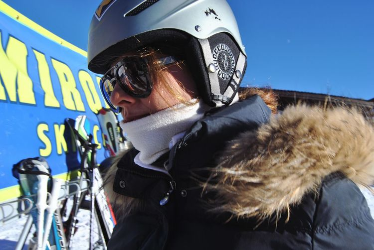 Close-Up Of Woman In Helmet And Sunglasses During Winter