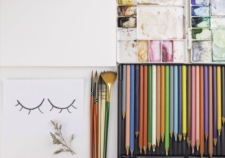 flat lay of Brushes, Paper and Palette of Watercolor on white table Flat Lay Wooden White Watercolor Water View Used Up Top Tools Sketchbook Set Paper Palette Paintbrush Paint Old Hobby Equipment Education Drawing Design Creativity Creative Colorful Color Close Brushes Artistic Artist Art Multi Colored Art And Craft No People Indoors  Pencil Choice Variation Still Life Writing Instrument Drawing - Art Product Pen Close-up Brush Craft Large Group Of Objects Colored Pencil Table Group Of Objects Art And Craft Equipment
