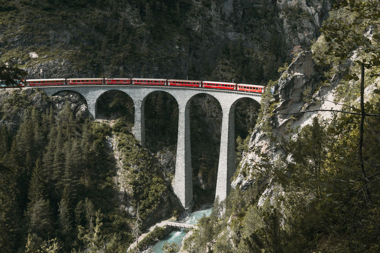 High angle view of train on landwasser viaduct by mountains