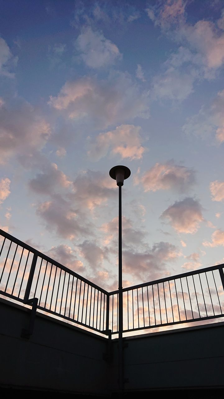 cloud - sky, sky, low angle view, built structure, architecture, street light, railing, street, nature, silhouette, lighting equipment, connection, no people, sunset, building exterior, bridge, outdoors, bridge - man made structure, day, metal, light