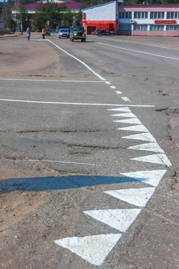 Fresh road markings. Asphalt City Day Outdoors People Road Road Marking Transportation Urban Road