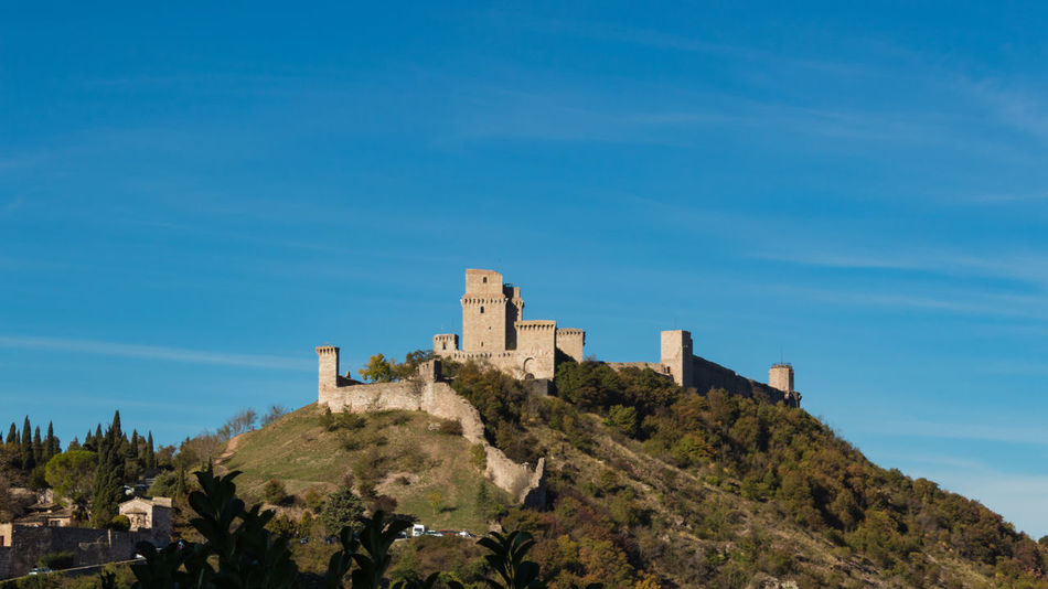 Architecture Blue Building Exterior Built Structure Castle Day Fort Fortress History Italy Low Angle View Nature No People Outdoors Sky Stronghold Travel Destinations Tree Umbria