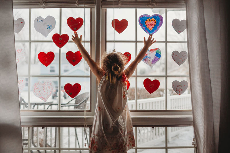 Window One Person Indoors  Rear View Standing Red Child Childhood Transparent Day Arms Raised Positive Emotion Valentine's Day  Valentine Activity Decorations Love
