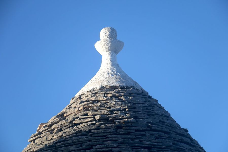 Alberobello Alberobello - Puglia Alberobelloexperience UNESCO World Heritage Site Architecture Beauty In Nature Blue Clear Sky Close-up Day Low Angle View Nature No People Outdoors Sculpture Sky Statue Trullo