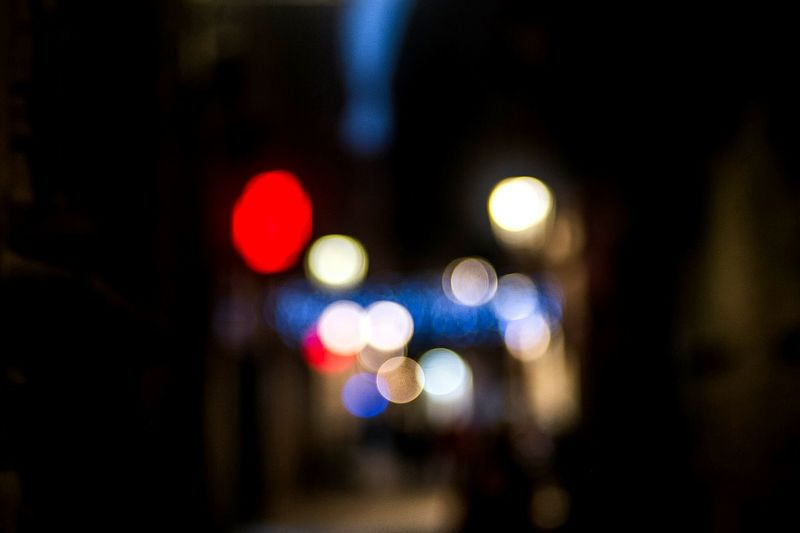 Defocused image of illuminated city at night