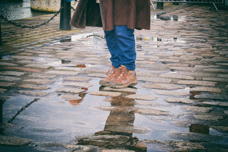 Rainy days indeed.... Colour Your Horizn Raining Rainy Days Adult Adults Only Day Female Human Body Part Human Leg Low Section Men One Person Outdoors People Puddle Puddle Reflections Rainy Day Real People Shoe Standing Walking Water Women Womens Feet Womens Shoes