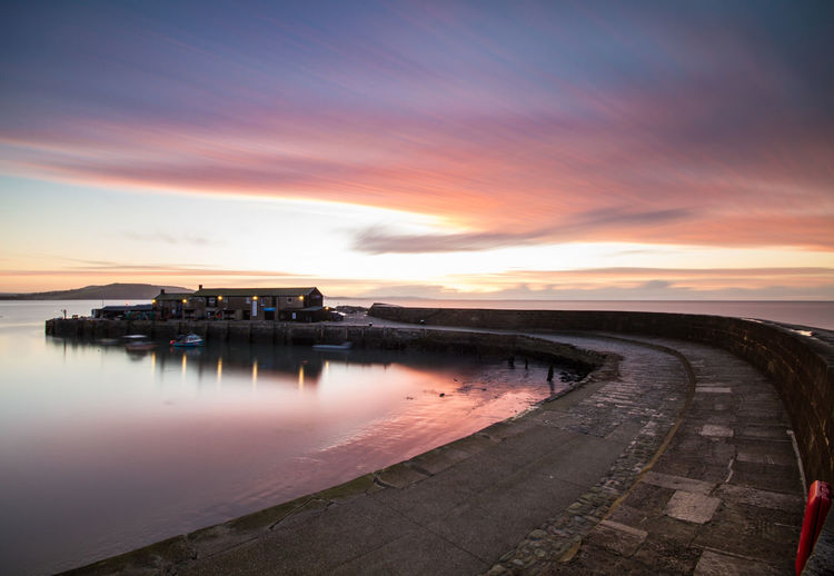 Architecture Beauty In Nature Dorset Coast Horizon Over Water Landscape Lyme Regis Nature Night No People Outdoors Reflection Scenics Sea Sky Sunset The Cobb Travel Travel Destinations Water