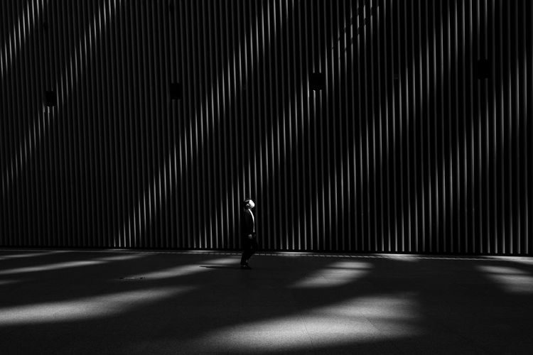 Shadow of man standing on illuminated floor