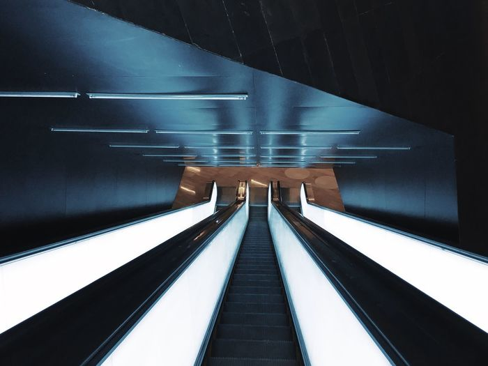 Low angle view of escalator at subway