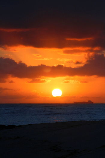 Atmosphere Atmospheric Mood Cloud Cloud - Sky Cloudscape Cloudy Distant Dramatic Sky Light Majestic Moody Sky Orange Color Outdoors Silhouette Silhouette Ship Sky Storm Cloud Sun Sunset Tranquil Scene