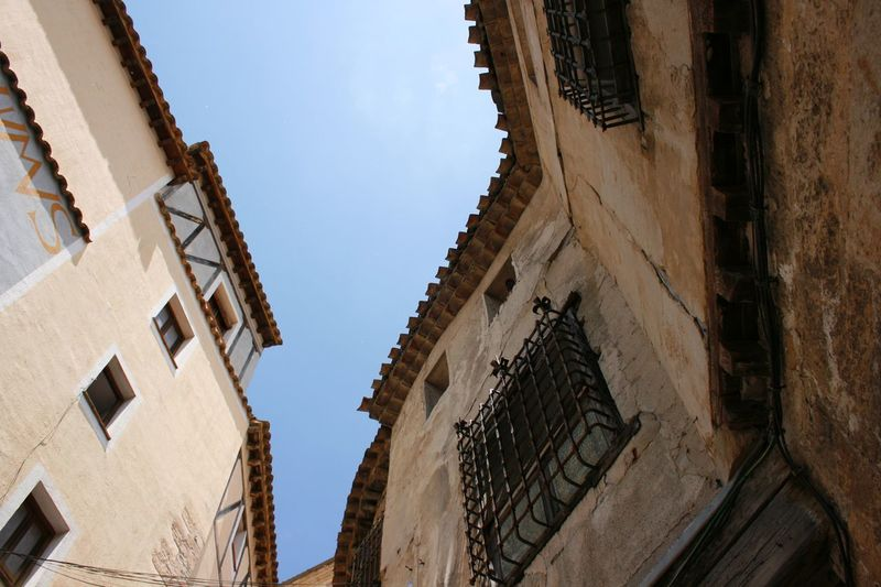 They are beautiful just the way they are. Architecture Architecture Architecturelovers Built Structure Cuenca, Spain Iron Grills Low Angle View Narrow Street Old Architecture Old City Old City Building Old Windows Stone Houses  TOWNSCAPE