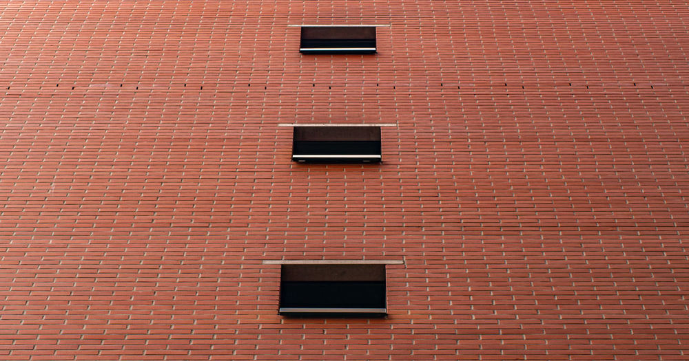 Low angle view of brick wall