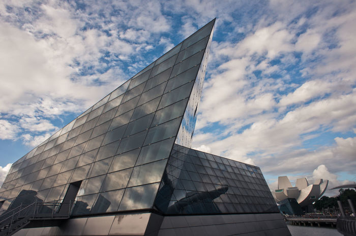 Avalon Low Angle View Architecture Building Exterior Cloud - Sky Outdoors No People Sky Façade Skyscraper Day Modern Avalon Harbor Geometric Shapes The Architect - 2017 EyeEm Awards Architecture Photography Architecture_collection Architectural Detail Architectural Design Architectural Column