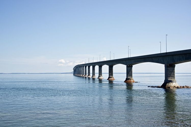 Canada: Confederation Bridge seen from New Brunswick side Confederation Bridge Daytime New Brunswick Road Architectural Column Architecture Beauty In Nature Blue Bridge Bridge - Man Made Structure Built Structure Communication Connection Copy Space Day Daylight Engineering Horizon Over Water Long Majestic Nature Outdoors Prince Edward Island Repetition Scenics - Nature Sea Sky Transportation Water Waterfront