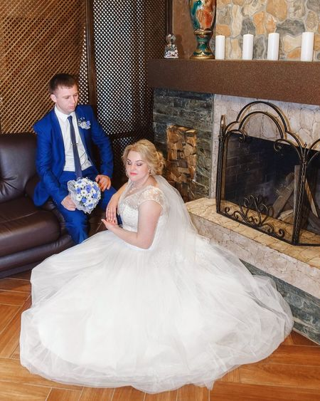 Two People Togetherness Bridegroom Wedding Dress Bride Happiness Indoors  Wedding Beautiful People Mature Adult Women Sitting Adult Happiness Young Adult Females Wife Men Married Adults Only Smiling Young Women Beautiful Woman (null)Day