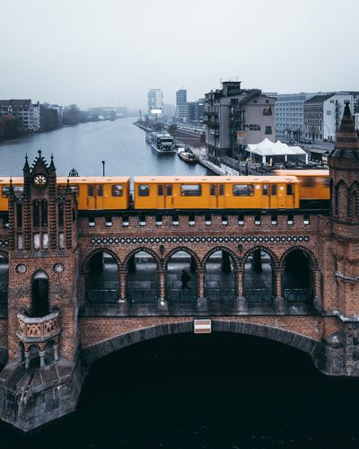 Oberbaumbrücke Bvg Berlin Architecture Built Structure Building Exterior City Sky Water Nature Transportation Building Mode Of Transportation Travel No People Car Bridge - Man Made Structure Bridge Day Outdoors Arch Motor Vehicle Cityscape