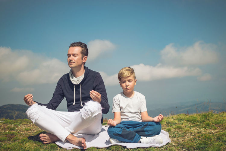 Father and son spending leisure time on mountain