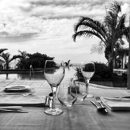 Place setting on table against sky
