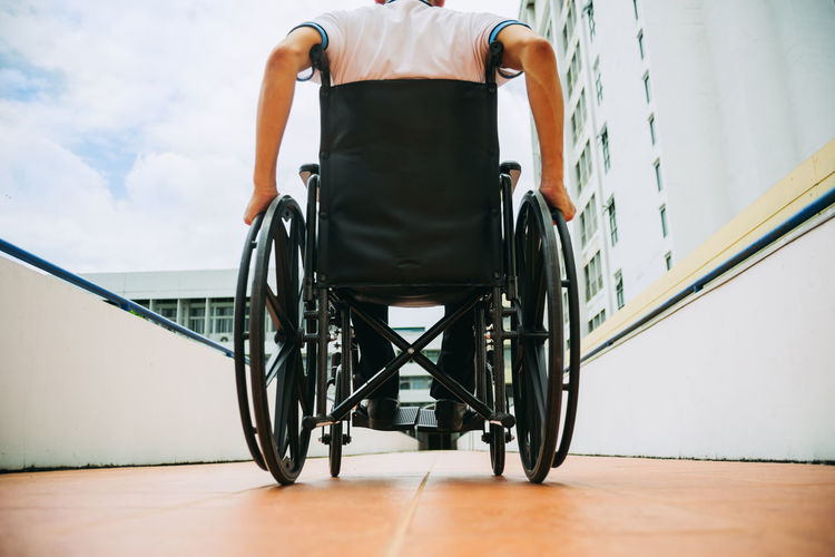 Rear view of man on wheelchair