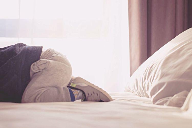 Boy lying on bed