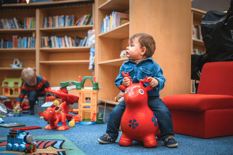 Deer Library Red Toys Blue Bookshelf Carpet Childhood Day Denim Full Length Indoors  Inflatable  Lifestyles Multi Colored Play Playground Playing Red Color Toy