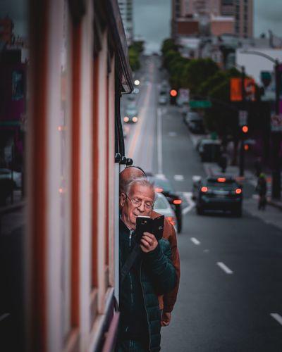 Full length of man standing on city street