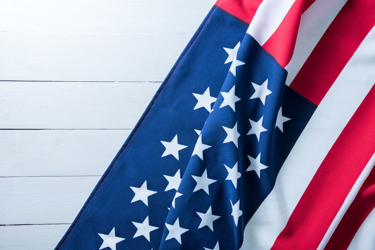 Close-Up Of American Flag Against White Wall