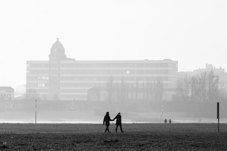 Düsseldorf, Germany Düsseldorf Rhein Rheinufer Rheinwiesen Bnw Building Exterior Built Structure Day Foggy Nature Outdoors People Real People