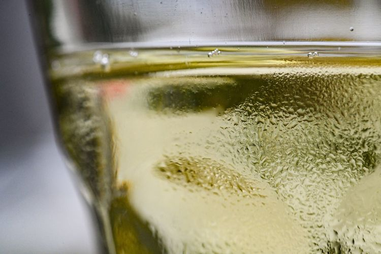 Chilling the most White Wine Macro Refreshment Drinking Glass Glass Drink Household Equipment Close-up Food And Drink Still Life Cold Temperature Alcohol Glass - Material Table Cold Drink Indoors  No People