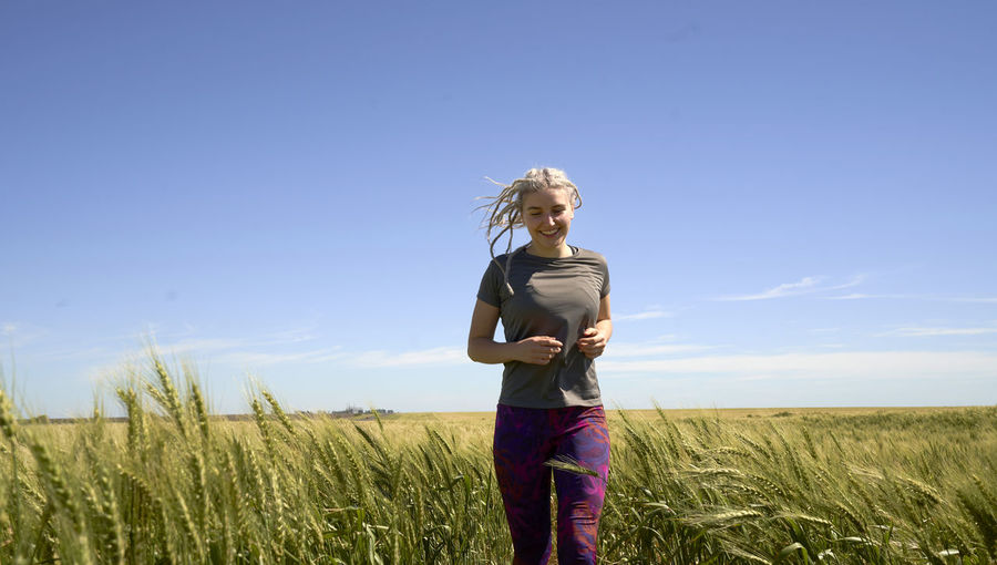 Full length of woman standing in field