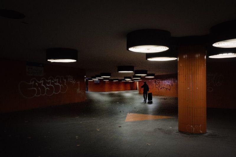 Orange Color Illuminated Indoors  Lighting Equipment Transportation Architecture Ceiling Walking Built Structure Direction Subway Wall - Building Feature Public Transportation Tunnel Incidental People City Flooring