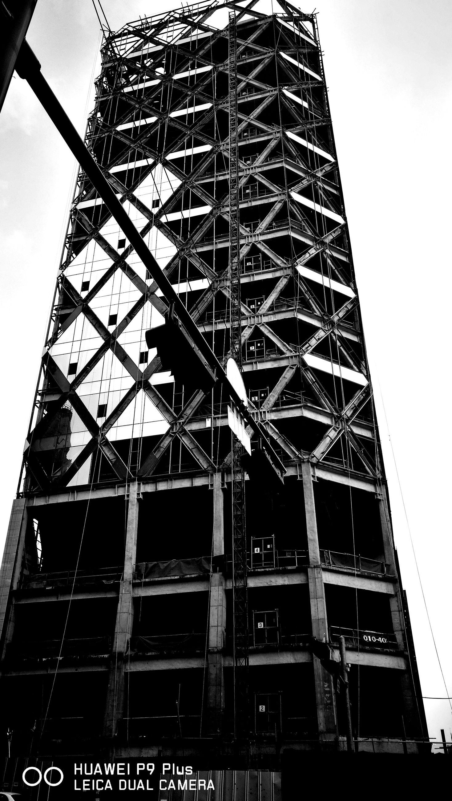 low angle view, built structure, architecture, tower, metal, no people, day, building exterior, outdoors, sky, iron - metal