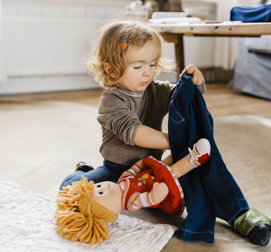 Cute Girl Playing With Toys At Home