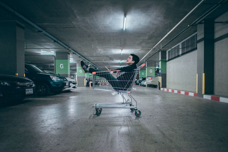 Street portrait Dark Architecture Car Casual Clothing Ceiling Child Direction Full Length Illuminated Indoors  Lifestyles Men Mode Of Transportation Motor Vehicle One Person Parking Lot Real People Shopping Shopping Cart Street Street Night Streetphotography The Way Forward Transportation Capture Tomorrow