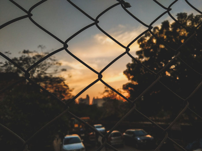 Chainlink Fence Fence Protection Security Metal Safety No People Sunset Silhouette Sky Defocused Nature Outdoors City Day Close-up