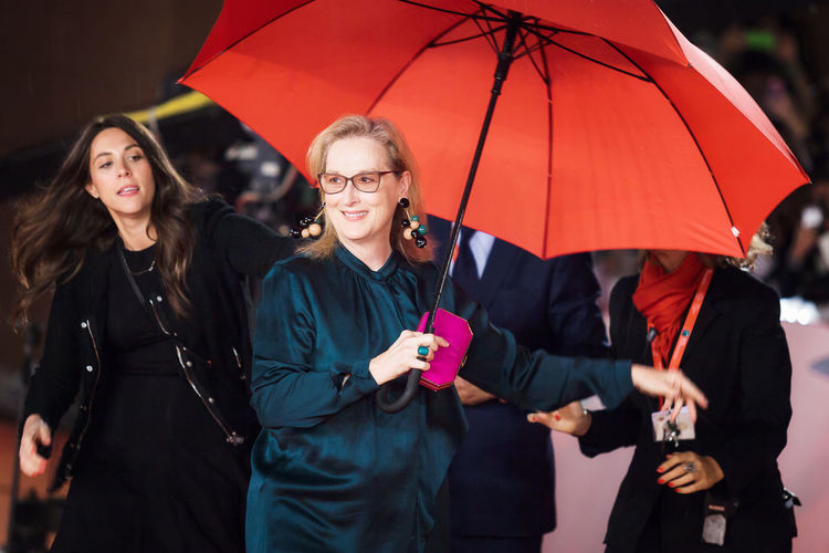 Rome, Italy - October 20, 2016. The actress Meryl Streep on the red carpet at the Rome Film Festival, with the open umbrella to a light rain. At the Auditorium Parco della Musica. Actress Celebrities Famous People Merylstreep Rain Red Carpet Rome Film Festival Umbrella