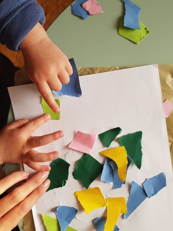 Teamwork Human Body Part Human Hand Art And Craft Creativity Indoors  Childhood Craft Child Multi Colored Paper Table Skill  Growing Up Large Group Of Objects Happiness The Week On EyeEm EyeEm Best Shots At Home Rainbow Colors Papercraft Mommy And Son Tear Apart Puzzle  Rainy Afternoon From My Point Of View
