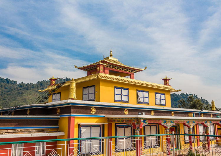 Tashijong Monastery near Palampur, Himachal Pradesh Vibrant Color Blue Sky Colorful Monastery Buddhism Buddhist Temple Palampur Baijnath Himachalpradesh Architecture Travel Destinations Palace History Travel Cloud - Sky Building Exterior Sky