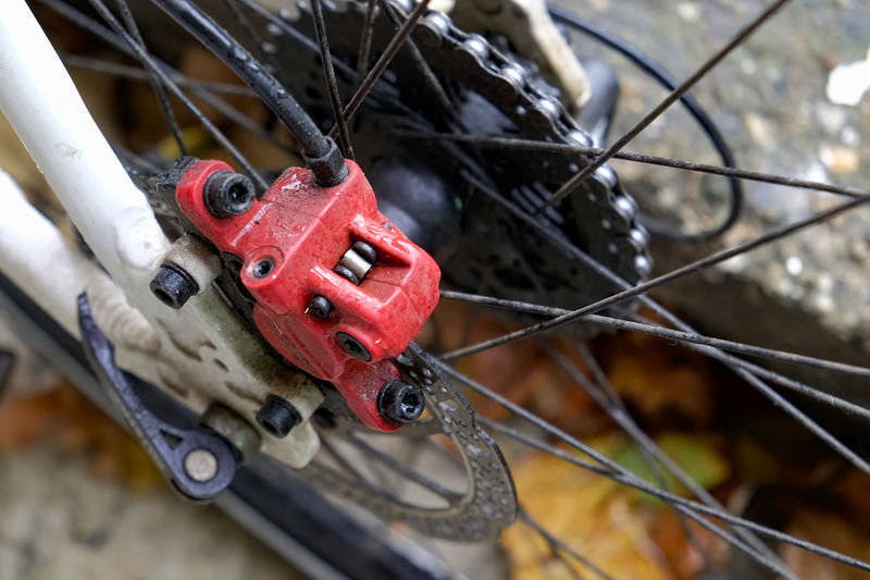 Close-up of bicycle on chain