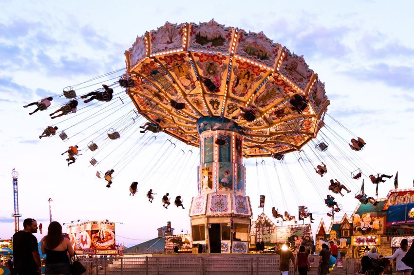 Amusement Park Group Of People Amusement Park Amusement Park Ride Real People Arts Culture And Entertainment Leisure Activity Crowd Sky Large Group Of People Cloud - Sky Enjoyment Lifestyles Chain Swing Ride Fun Carousel Outdoors