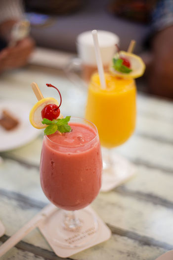 Close-up of juices served on table